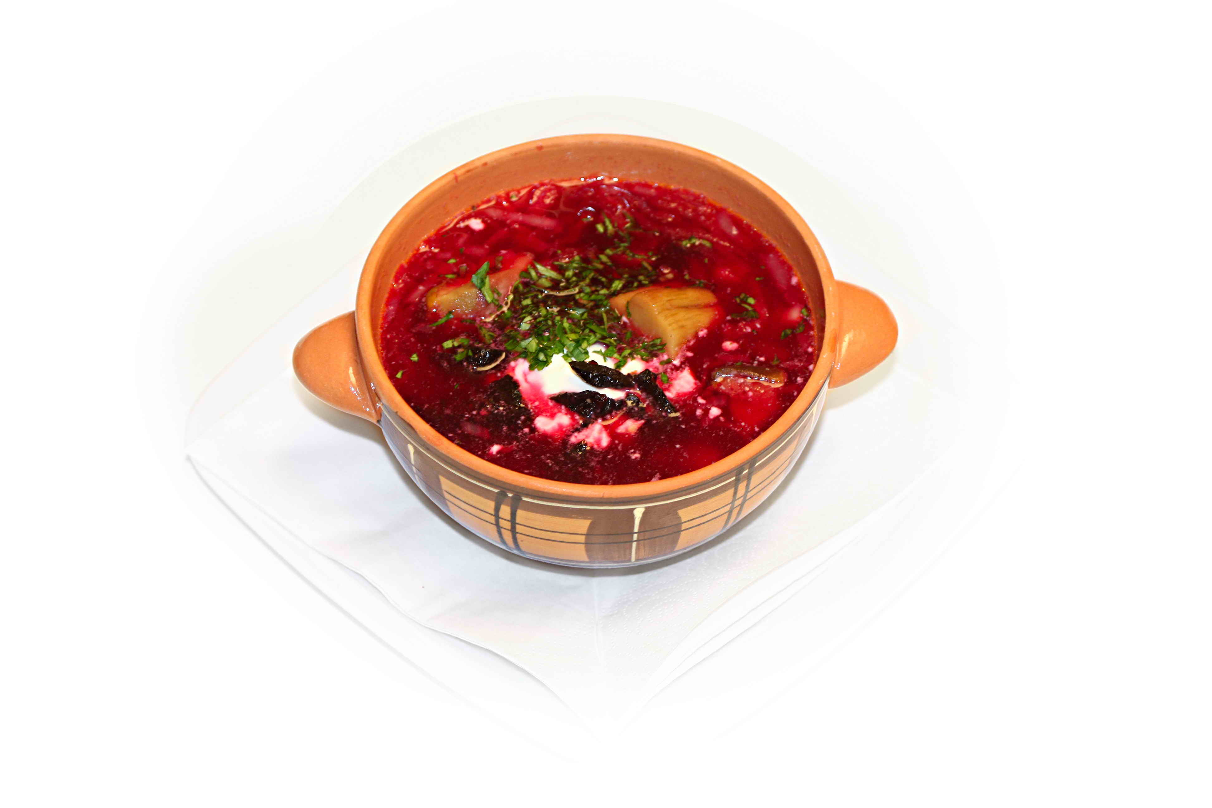 Borshch with dried plums and porcini