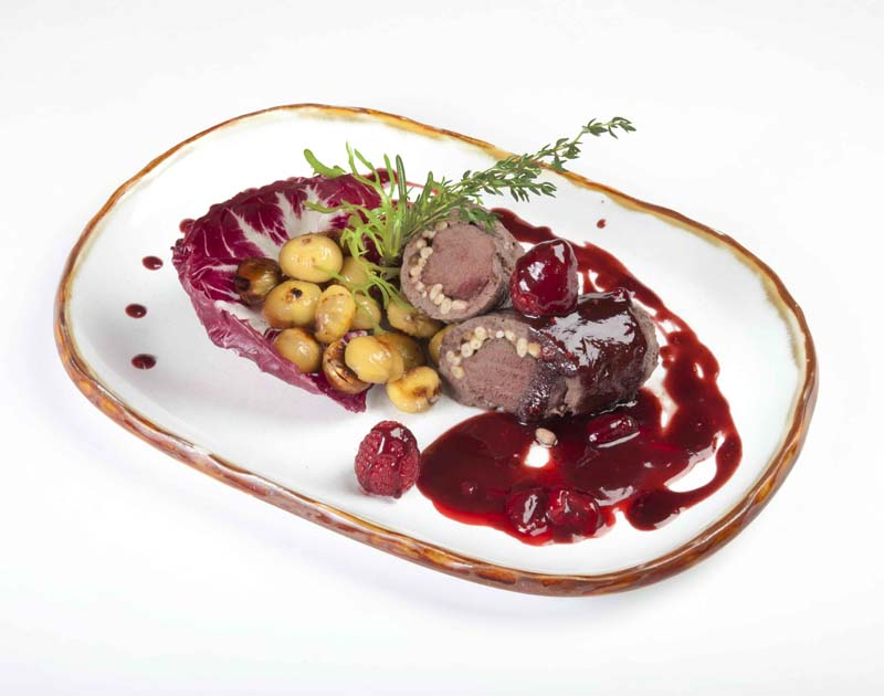 Venison sirloin in the mousse with cedar nuts,   roasted chestnuts and raspberry sauce